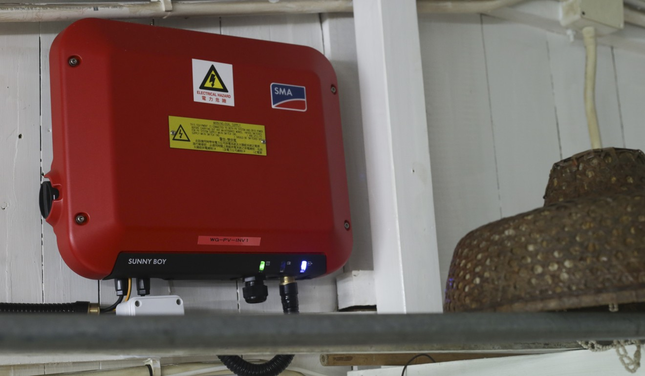 Hong Kong Villagers Using Solar Energy To Help Power Their Homes Fuse Box City The Red Is An Inverter That Converts Dc Electricity From Panel Into Ac Used In Home Photo May Tse