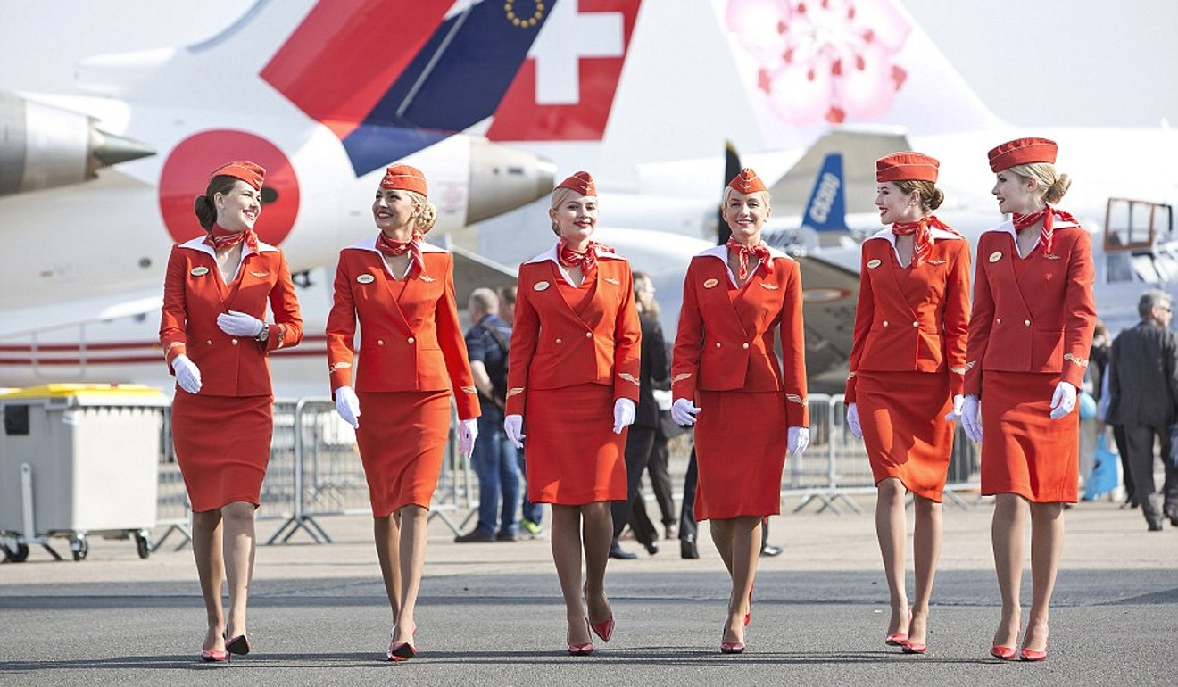 Aeroflot stewardesses display their red-orange livery.