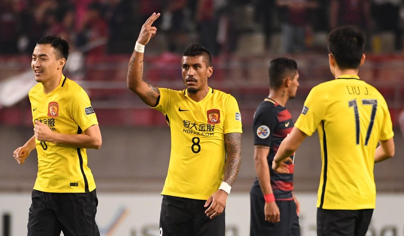 Guangzhou Evergrande s Paulinho set to join Barcelona says