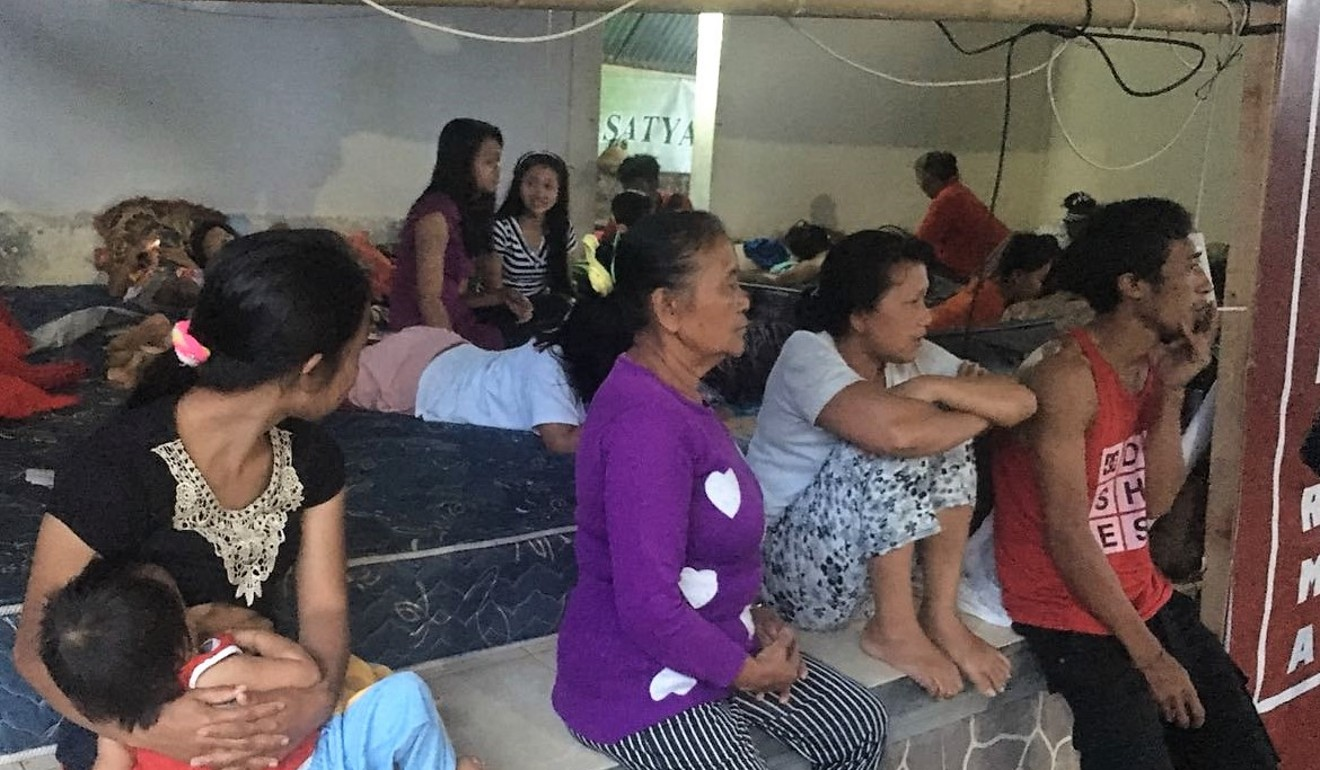 Bali residents rest at a relief centre on the island. There have been 471 relief centres set up to take in evacuees.