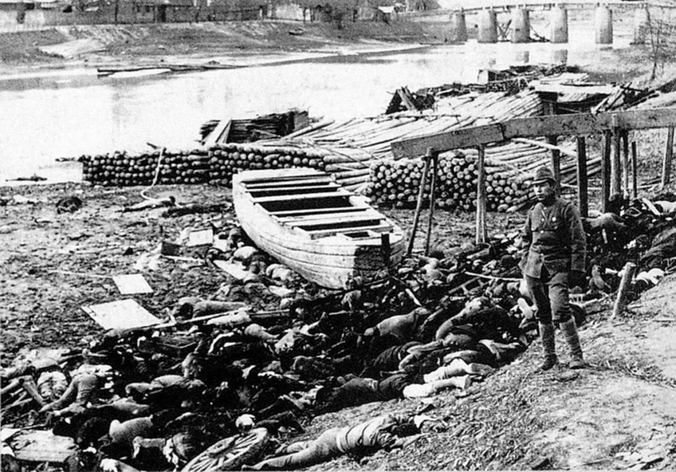 The corpses of victims wash up on the banks of the Qinhuai River.
