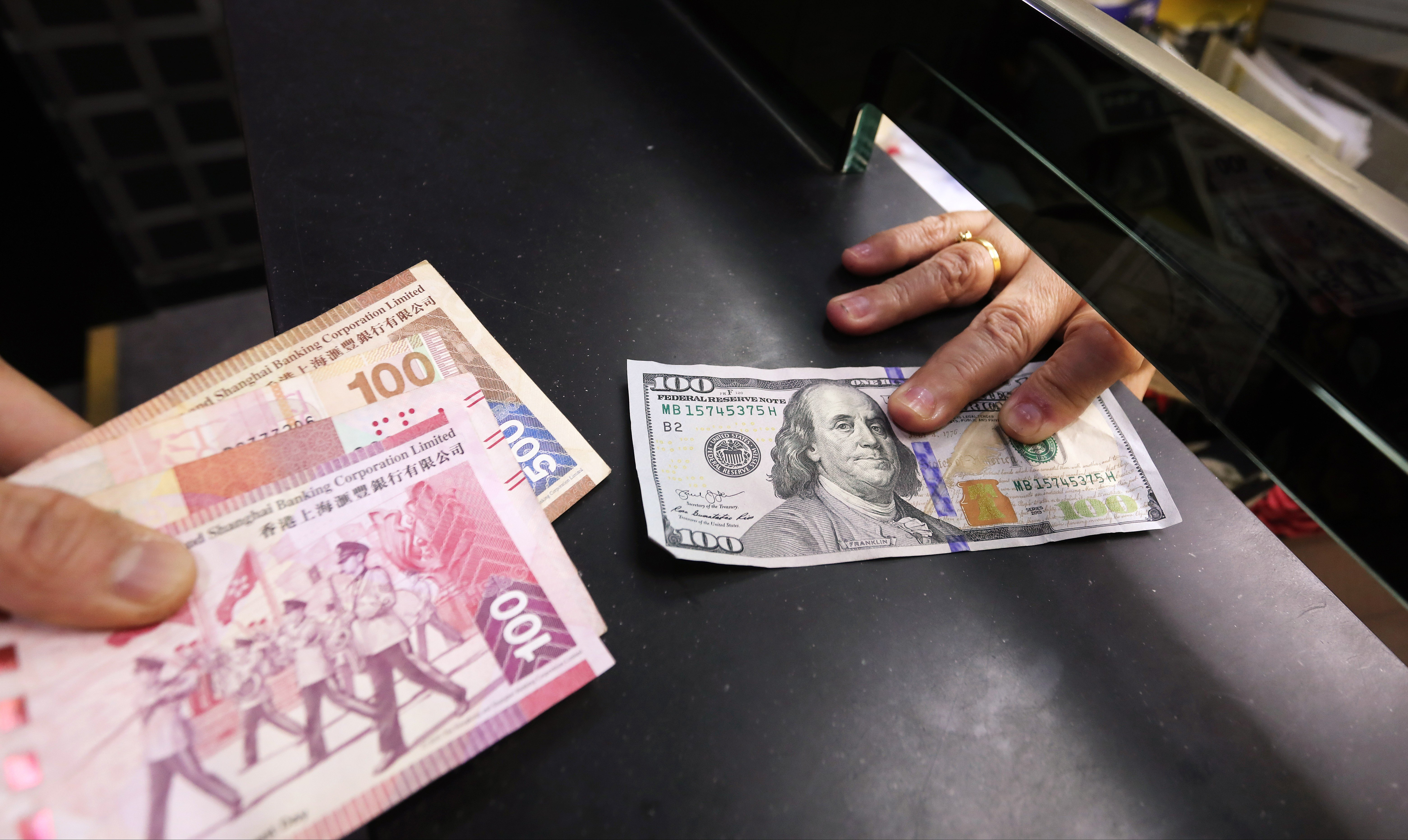 Hong Kong bankers and brokers see their bonuses fall by a