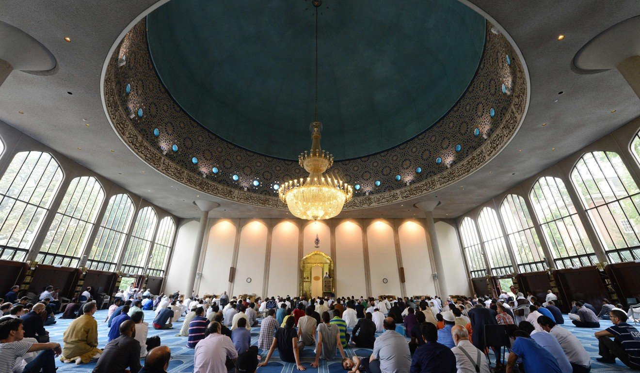 Muslim men attend prayers on Eid al-Fitr at the London Central Mosque. Photo: AFP