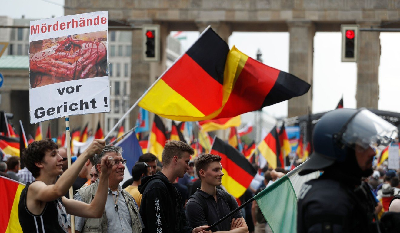 "Right-wing AfD protesters wave German flags in front of the Brandenburg Gate in Berlin during the ""demonstration for the future of Germany"" in Berlin on May 27. Photo: AFP"