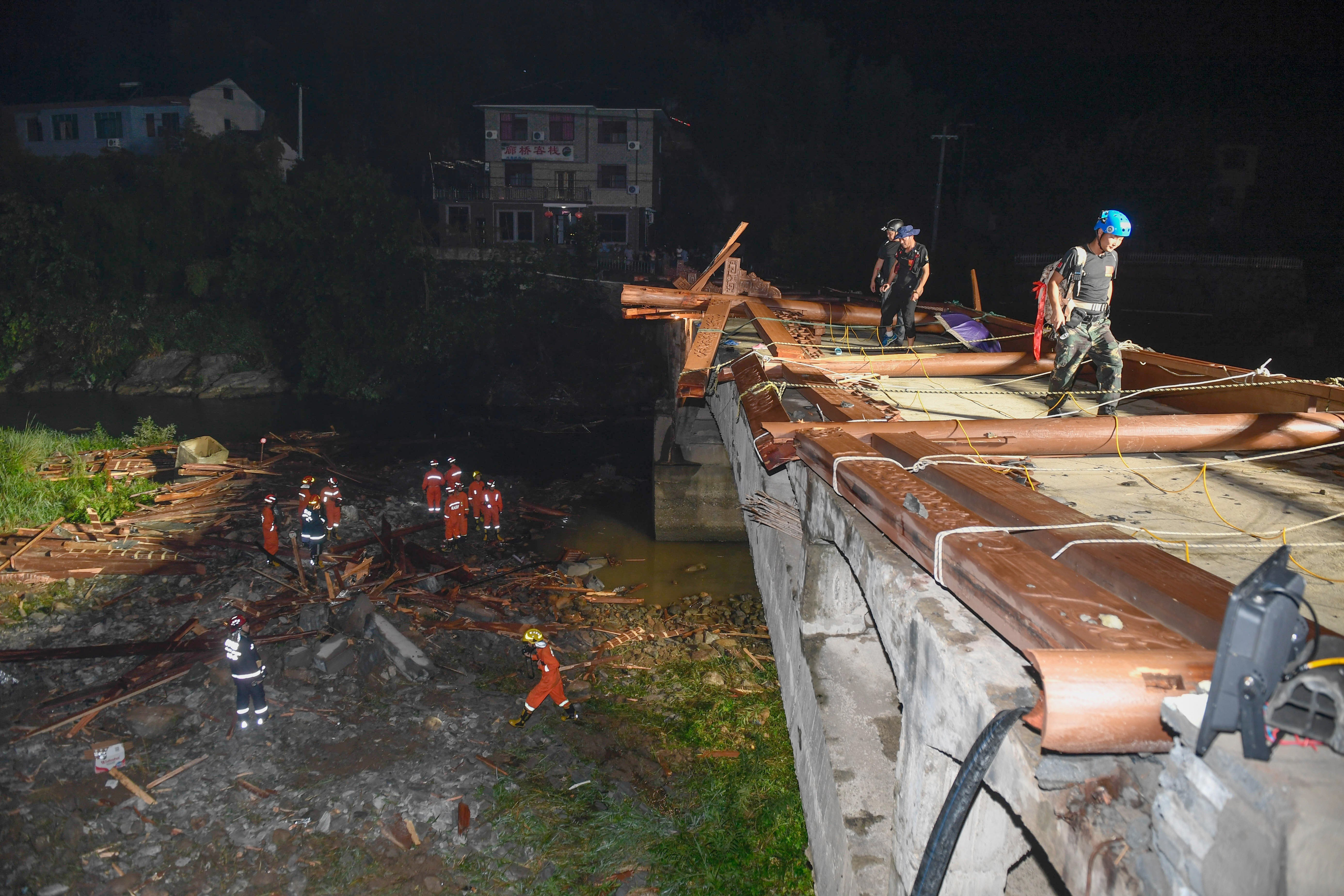Chinese truck driver collapses steel bridge and dumps 100