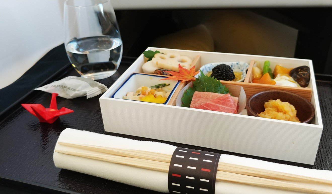 Japan Airlines' business class bento box: vegetables in sesame cream, tuna sashimi, cauliflower purée, bonito broth jelly with caviar. Photo: Nik Loukas