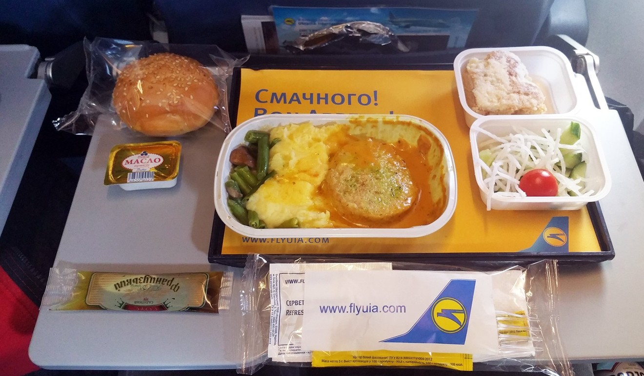 Ukraine International Airlines served a rather sad-looking chicken burger swimming in a light brown sauce with mashed potatoes and vegetables. Photo: Nik Loukas