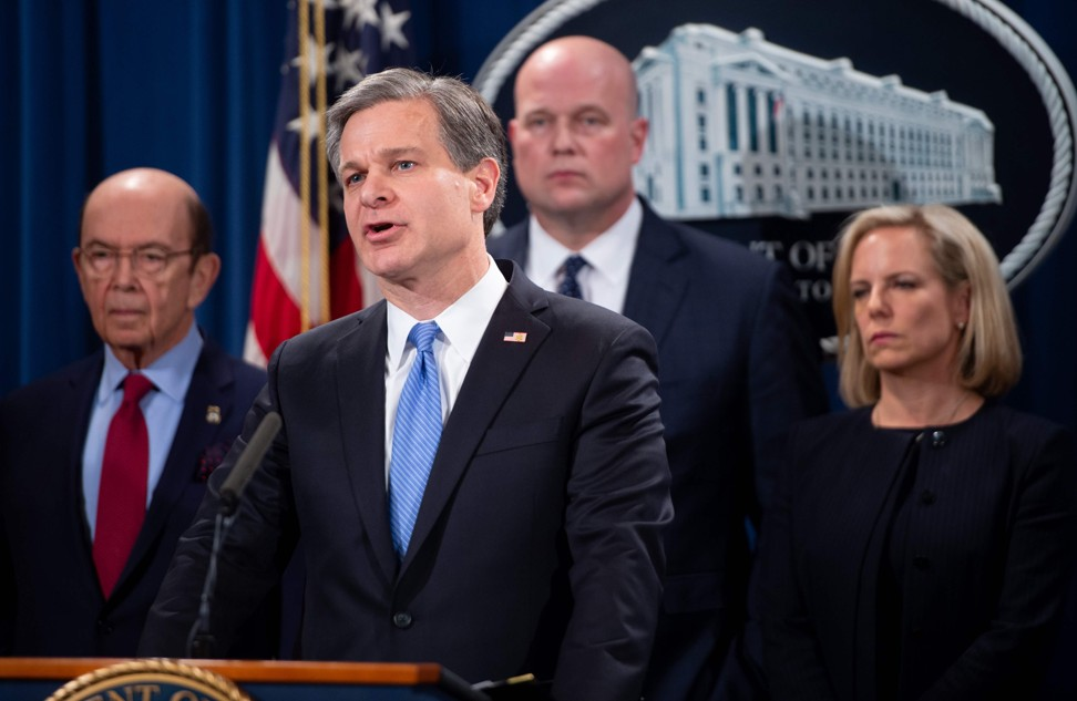 FBI Director Christopher Wray speaks alongside (from left) US Commerce Secretary Wilbur Ross, then acting Attorney General Matthew Whitaker, and Secretary of Homeland Security Kirstjen Nielson as they announce indictments against Huawei and Meng Wanzhou on January 28. Photo: AFP