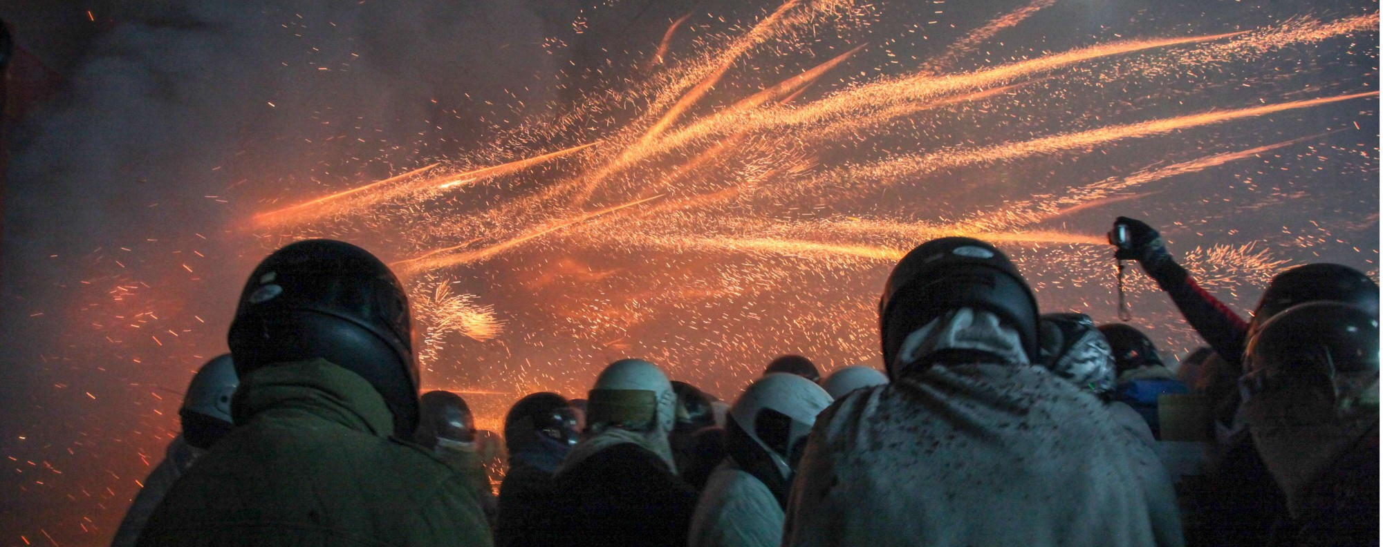 "Festival-goers watch as rockets from a ""beehive"" explode. Photo: Paul Ratje"