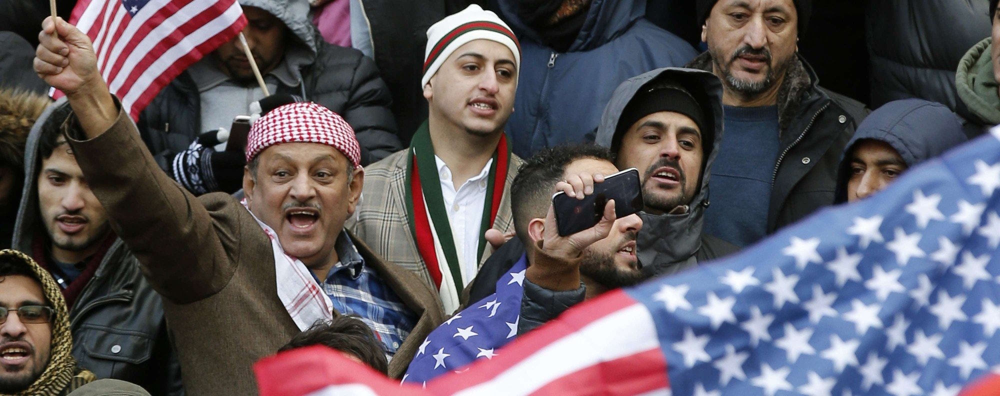 Muslims and Yemenis in Brooklyn protest the travel ban. Photo: AP
