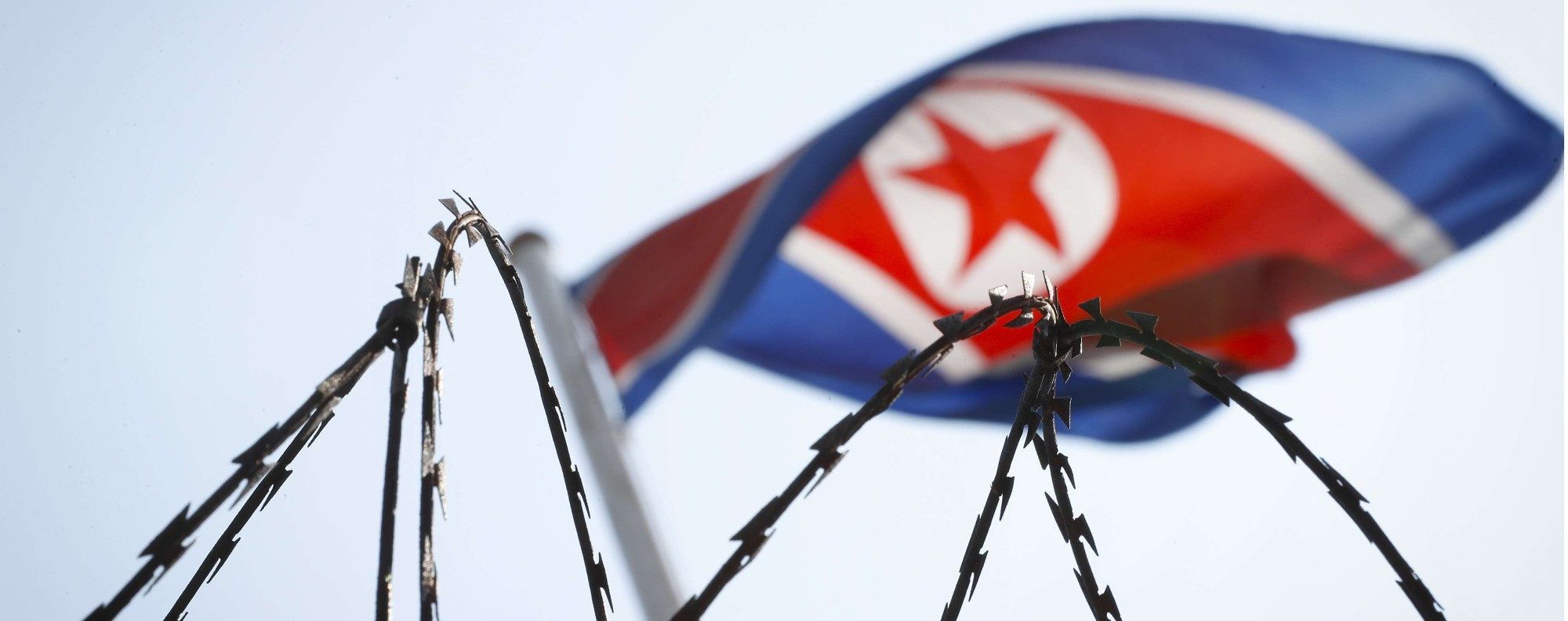 The North Korean flag behind razor wire in Malaysia. Photo: AP