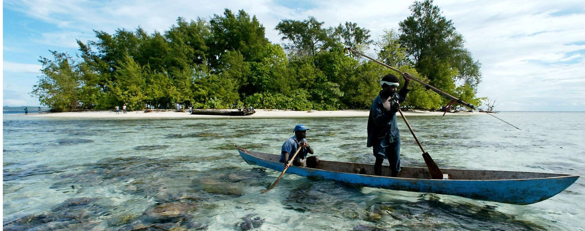 Fishermen paddle off Kennedy Island, in the remote Western Province of the Solomon Islands. Pictures: Julian Ryall; AFP; Alamy