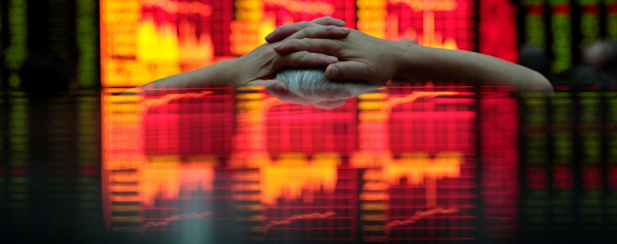 A man at a brokerage house in Shanghai. Photo: Reuters