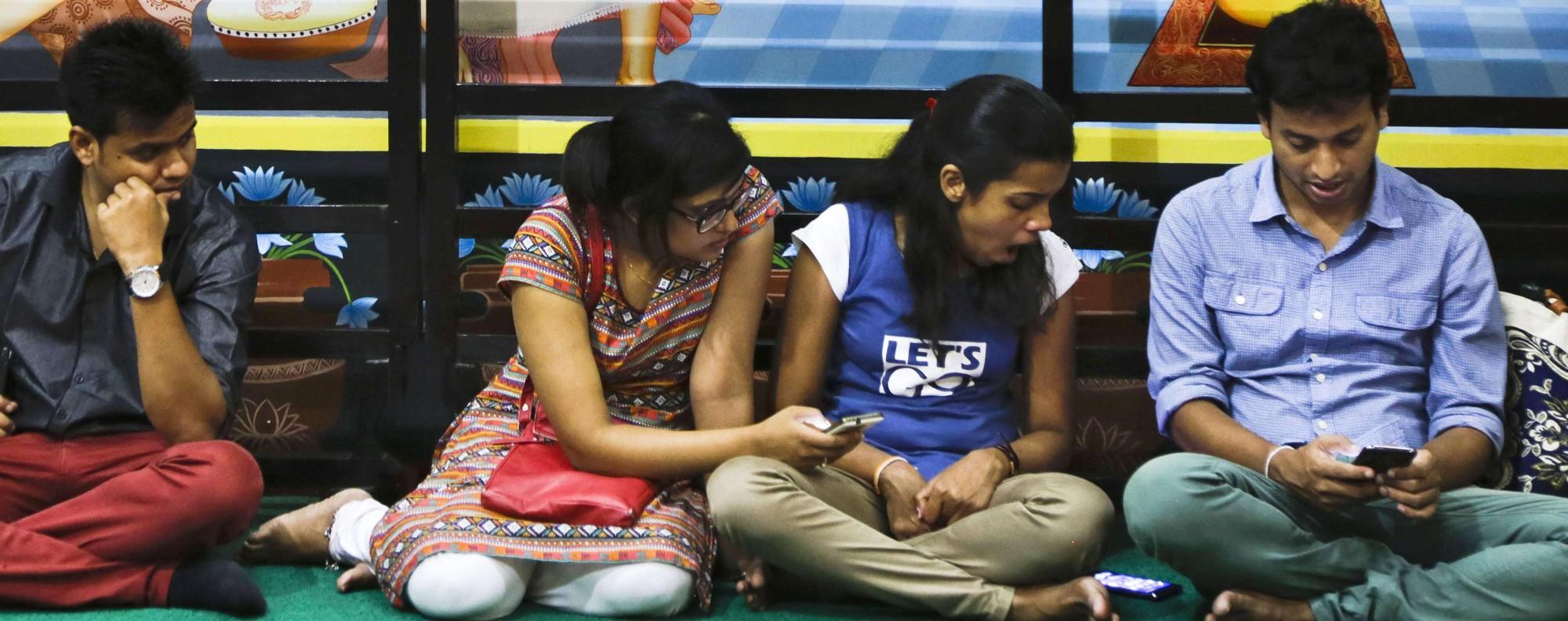 Mobile phone users in Kolkata, India. Photo: AP