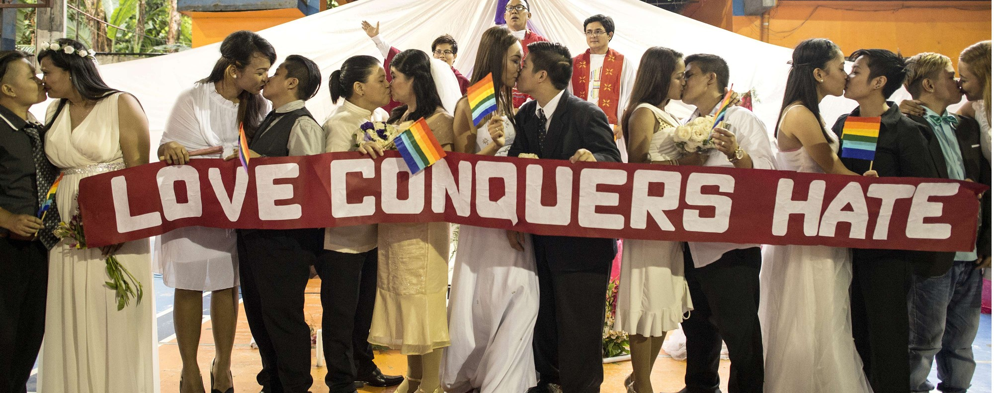LGBT couples kiss in a 'Rite of Holy Union' ceremony in Manila. Photo: AFP
