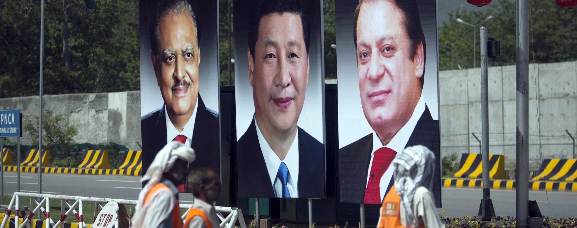 Posters of Chinese and Pakistani leaders in Islamabad. Photo: AP