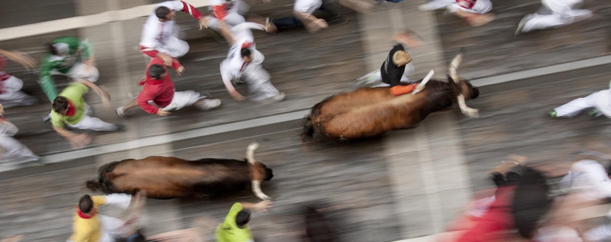 The bull run in Pamplona, Spain.