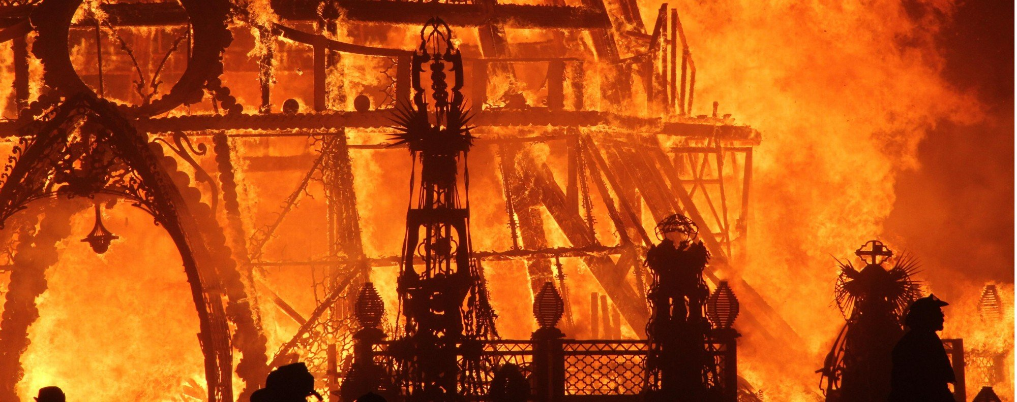 The Burning Man statue goes up in flames on the final night of the 2014 event.
