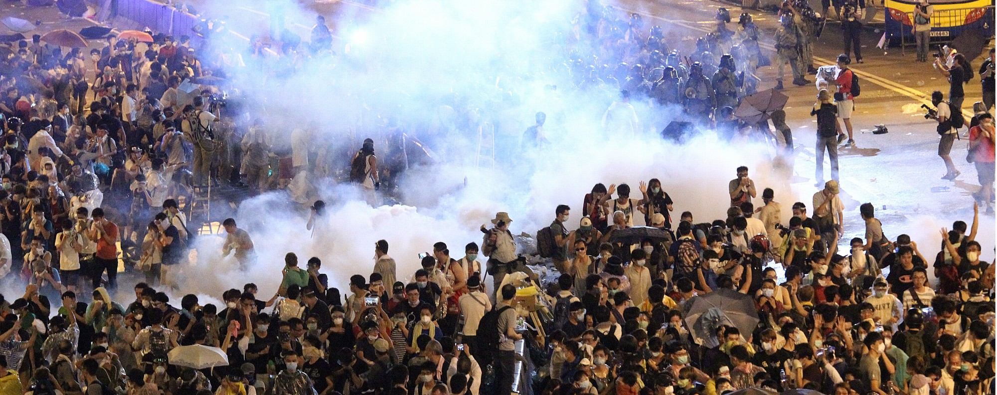 Holy smoke? Tear gas is used on Occupy protestors.