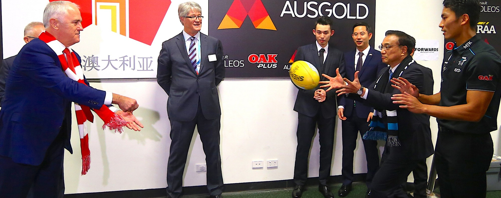 Australia's prime minister passes a ball to China's premier. Photo: AFP