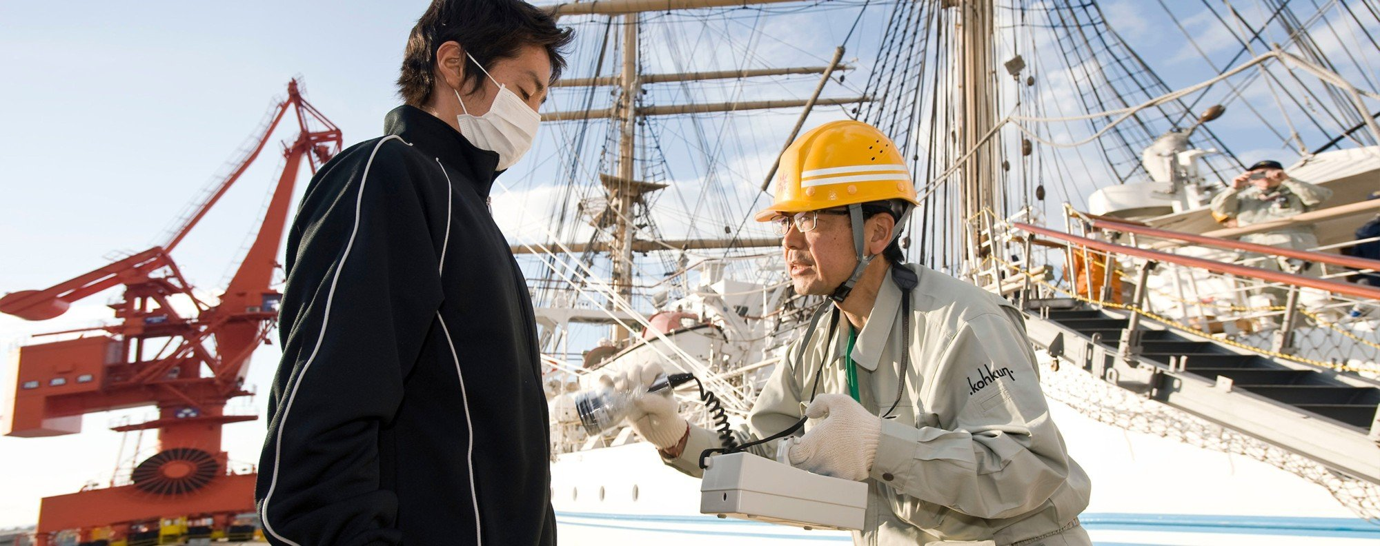 A member of the Fukushima 50 (left) is given a radiation check. Picture: Rob Gilhooly