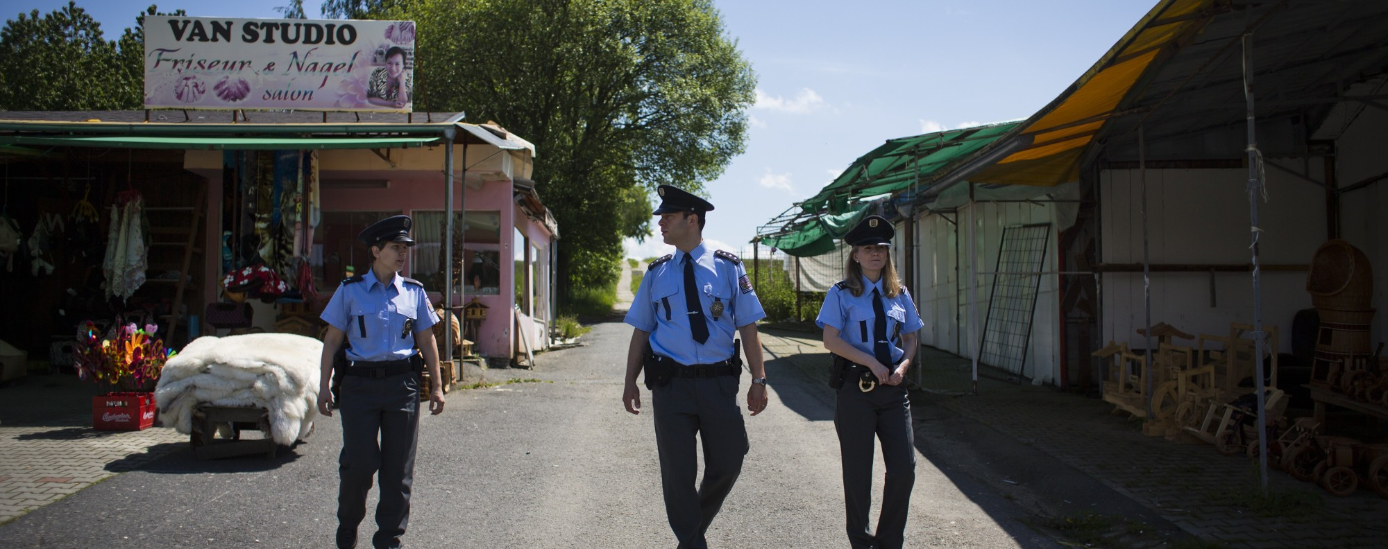 Czech police walk through an Asian market. Picture: Getty Images