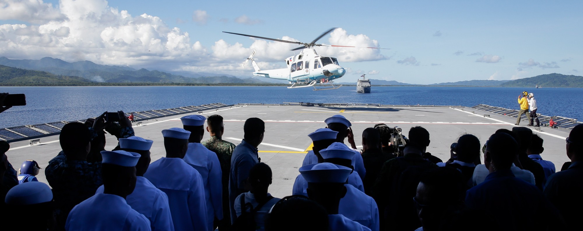 Rodrigo Duterte touches down on the BRP Davao del Sur. Photo: EPA