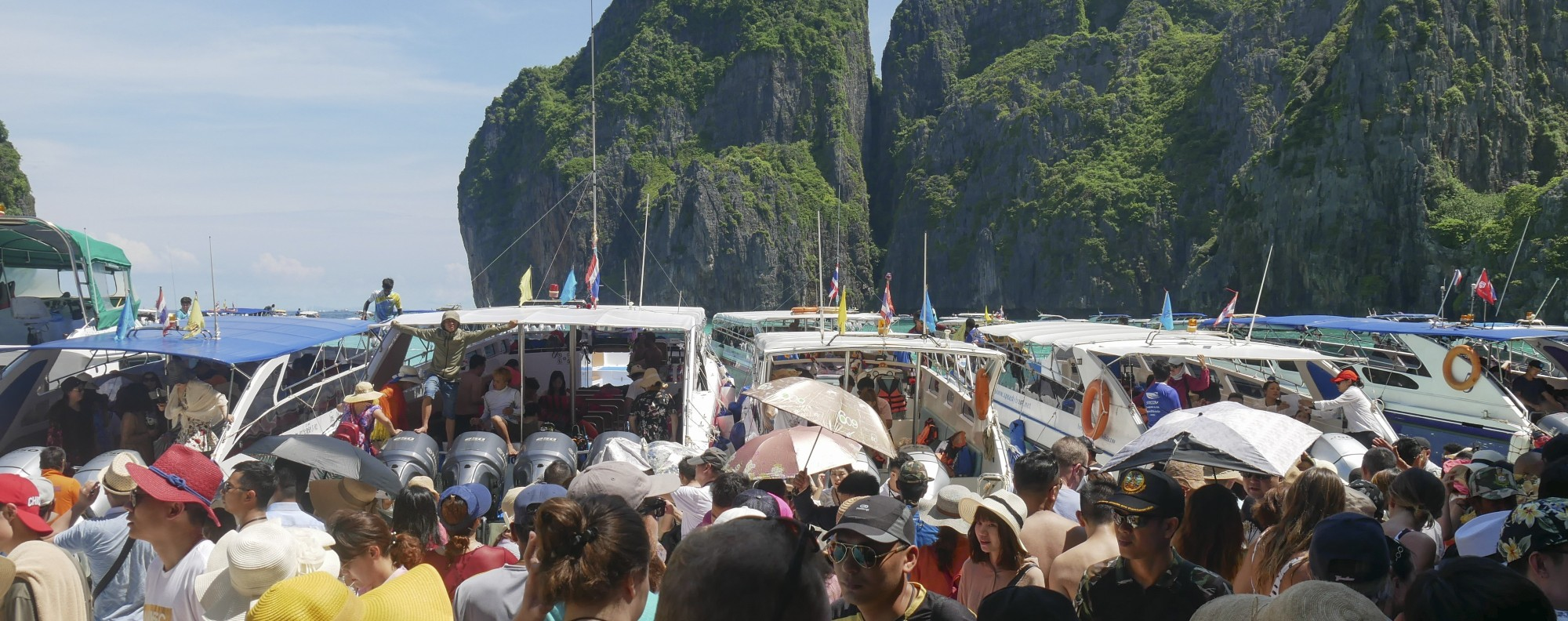 The tourist hordes at Maya Bay, just days before it was closed. Picture: Stuart Heaver