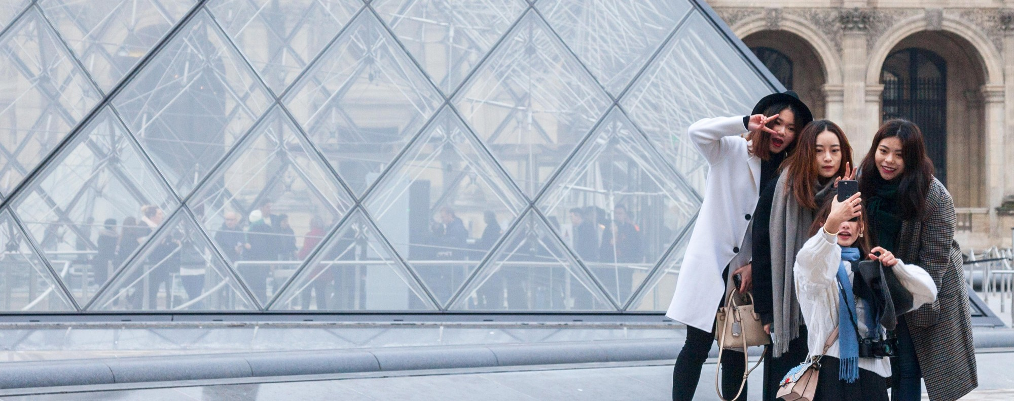 Chinese tourists at the Louvre Pyramid, in Paris, France. Picture: Alamy
