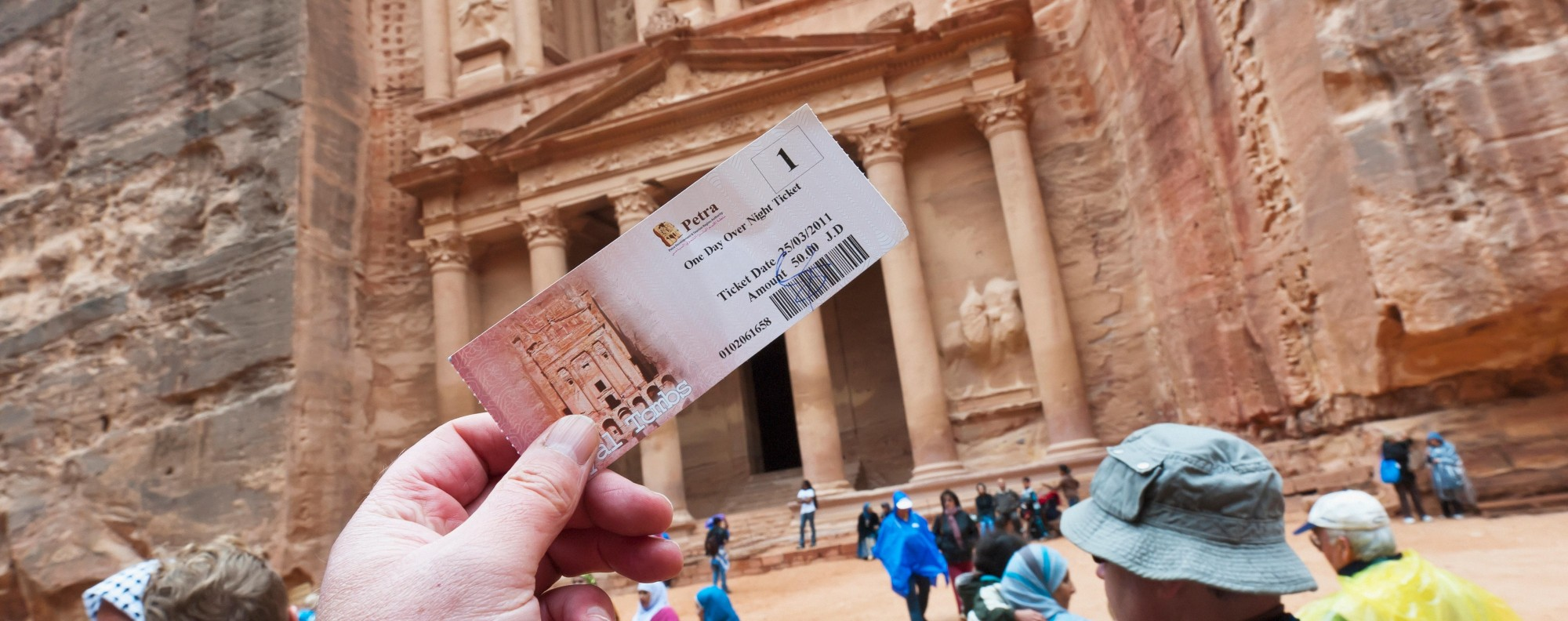 A tourist holds up his entrance ticket to Petra, in Jordan. Picture: Alamy