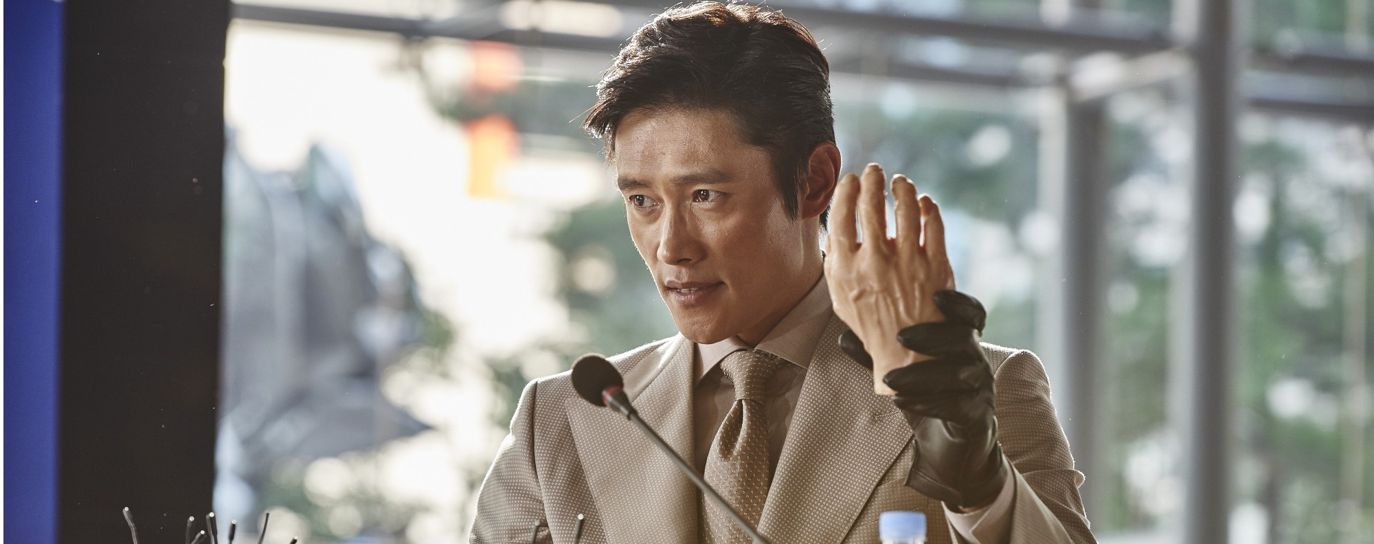 Lee Byung-hun playing a political henchman out for revenge in Inside Men.