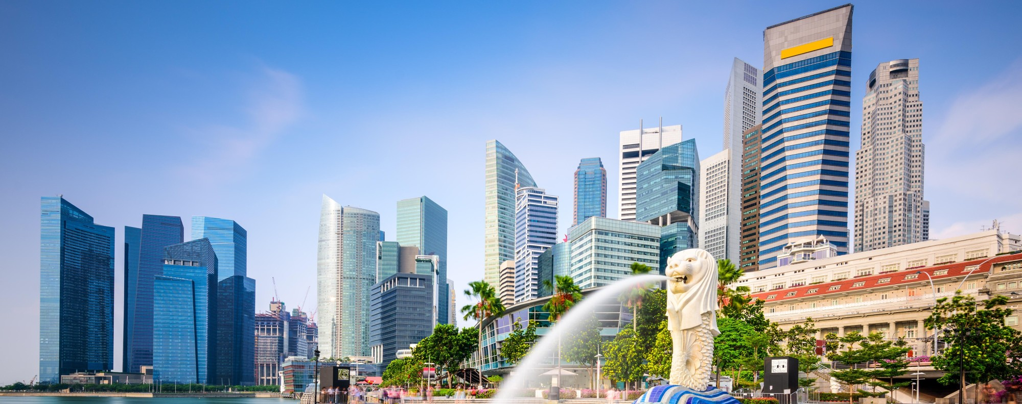 One time use only. for Go Asia -Singapore Singapore skyline at the Merlion fountain.