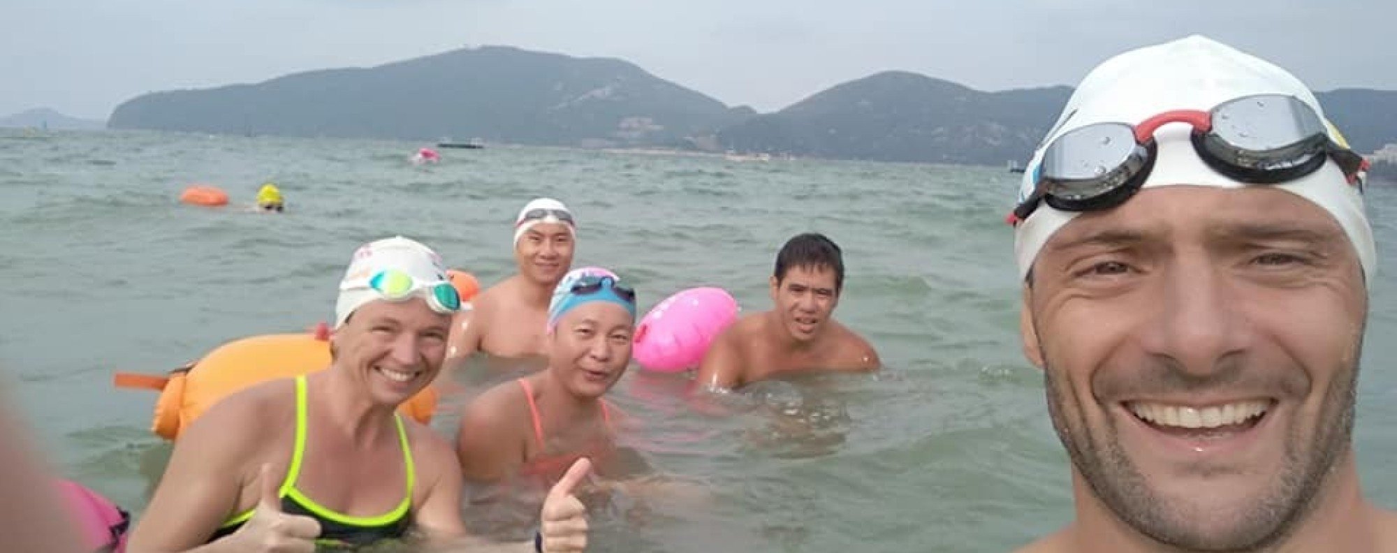 Olivier Courret with members of Hong Kong Open Water Swimmers. Photo: Handout