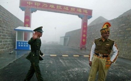 A Chinese soldier with an Indian soldier at a border crossing on the ancient Silk Road. The two sides clashed in a border war in 1962 and have since observed an undemarcated Line of Actual Control. Photo: AFP