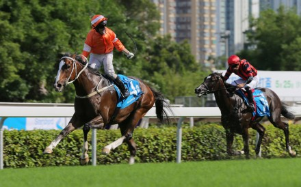 Neil Callan salutes as he wins the Champions & Chater Cup on Blazing Speed. Photo: Kenneth Chan