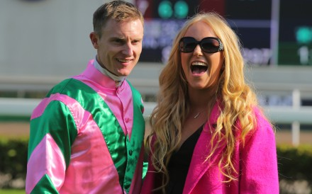 Zac Purton celebrates his Hong Kong Sprint win with wife Nicole. Photo: Kenneth Chan
