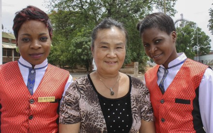 Golden Chopsticks hotel owner Liu Xiuyi with two of her staff in Livingstone, Zambia. Picture: Jenni Marsh