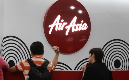 Travellers wait at AirAsia sales counter. Photo: AP