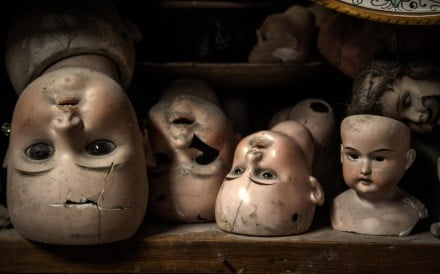 Broken heads of antique dolls line the hospital's shelves.