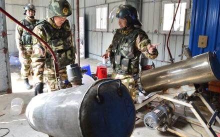 Paramilitary police inspect machines used to manufacture crystal meth following a raid in Boshe village, Lufeng, in Guangdong province. Photos: SCMP; Corbis; Xinhua