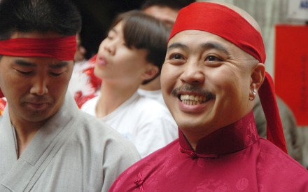 "FILE - In this Aug. 6, 2006 file photo, Raymond ""Shrimp Boy"" Chow smiles after being sworn in as the ""Dragon Head"" of the Chee Kung Tong in Chinatown in San Francisco. Chow, a central figure in a sweeping San Francisco organized crime and public corruption case, pleaded not guilty. The FBI spent many millions of dollars and used more than a dozen undercover operatives posing as honest businessmen and Mafia figures alike during its seven year organized crime investigation centered in San Francisco's Chinatown. Now, an increasing number of the defendants caught up in the probe that has ensnared a state senator and an aide are arguing that the FBI and its undercover agents are guilty of entrapment, luring otherwise honest people to go along with criminal schemes hatched by federal officials. (AP Photo/Sing Tao Daily, File)"