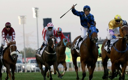 Damian Browne celebrates after leading Buffering to win the Al-Quoz Sprint during the Dubai World Cup meeting. Photo: AFP