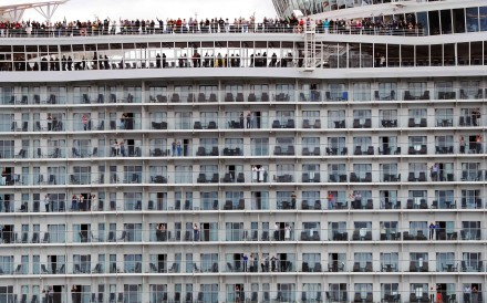 Passengers wave from the decks as the Harmony of the Seas cruise ship sets sail from Southampton on Sunday. Photo: AFP