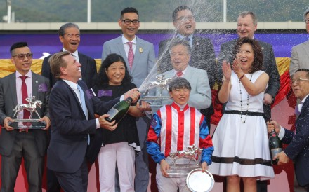 John Size celebrates after clinching the trainers' championship. Photo: Kenneth Chan