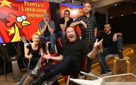 Comedy troupe members (from left) Kay Ross, Pete Grella, Ian Hughes, Zak Knudsen, Christopher Carmon Jr and Chris Coleman (front centre) at The Hub, a venue in Wan Chai. The group have been performing in Hong Kong for nine years. Photos: Nora Tam