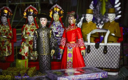 "Dolls represent the happy couple in a Chinese-style ""ghost wedding""."