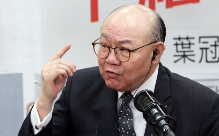 Retired judge Woo Kwok-hing appearing on a radio programme at Commercial Radio in Kowloon Tong on Friday. Photo: Edward Wong