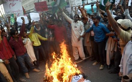 Pakistani protesters burn an effigy of Indian Prime Minister Narendra Modi in Karachi. Photo: AFP