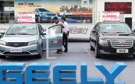 A Chinese visitor tries out Geely's Emgrand car at an auto show in Nanjing. Photo Imaginechina