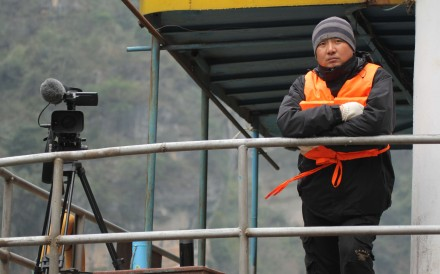 Chinese film director Xu Xin in a still from his documentary A Yangtze Landscape.